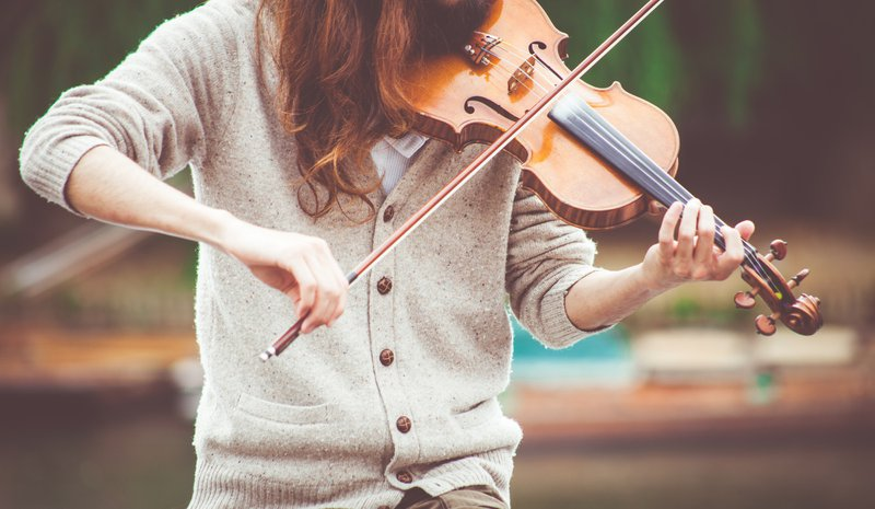 Outdoors violinist in a sweater. Representative image for Creative Commons music. Blog of Amar Vyas