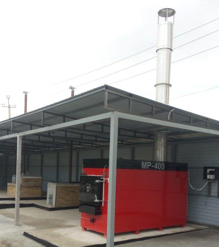 De Montfort Medical Waste Incinerator under a shelter with an MP400