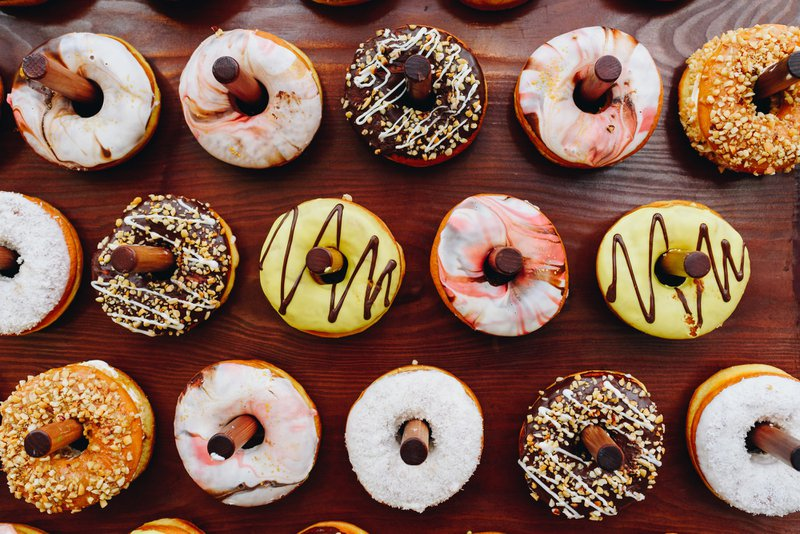 Delicious sweet donuts or doughtnuts on a special stand at a party or event, dessert, desserts, sugar, treat, sweets