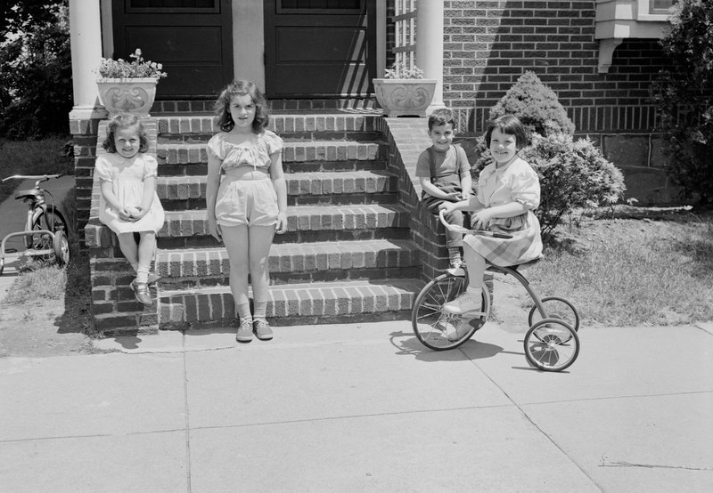 Three girls, one on tricycle and one boy in front of steps.Photographer:Abdalian, Leon H., 1884-1967. Date:June 22, 1950https://ark.digitalcommonwealth.org/ark:/50959/fj237q03jPlease visit Digital Commonwealth to view more images: https://www.digitalcommonwealth.org.