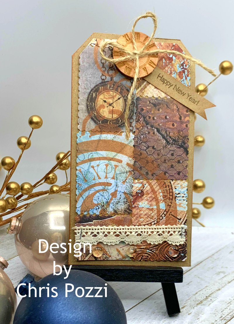 Create a quick and easy New Year Tag with FotoBella Guest Designer Chris! She used the Stamperia Clockwise Collection found at FotoBella.