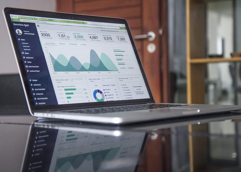 a laptop with analytics on the screen