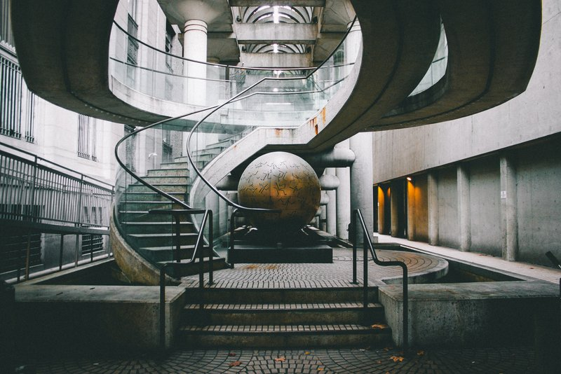 Metal sphere under a staircase