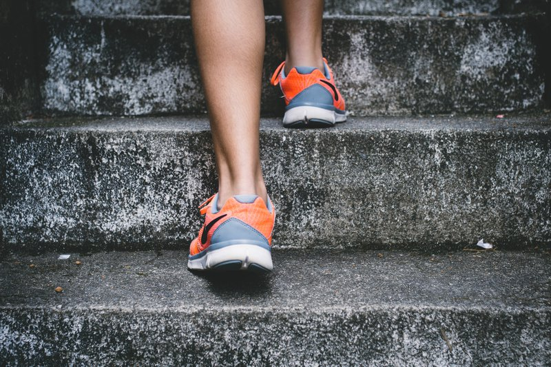 Close up of feet in sneakers walking up stone steps / Photographer: Bruno Nascimento   Source: Unsplash