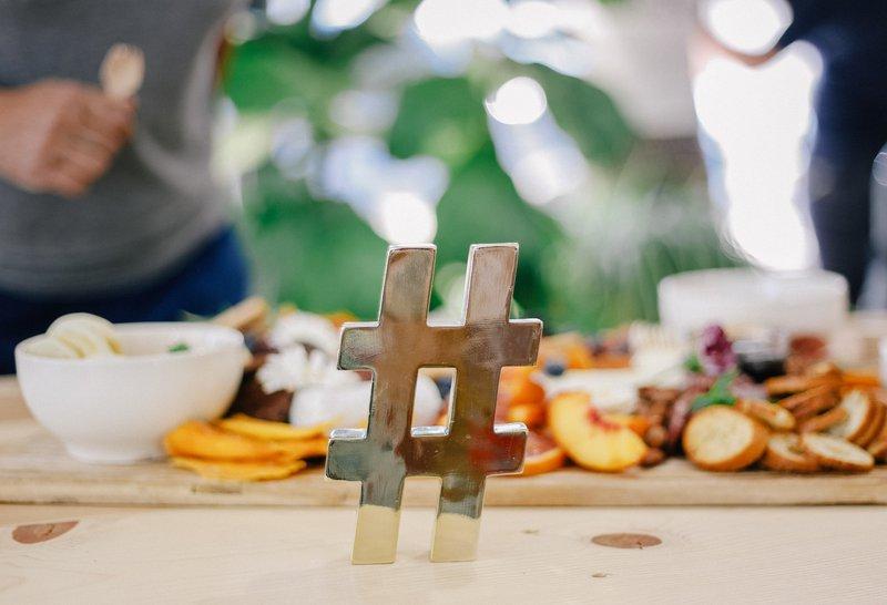 hashtag table decoration. Photographer: Allie Smith | Source: Unsplash
