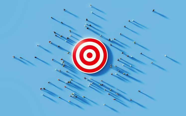 Human around a red bulls eye to show Concentrated Marketing concept
