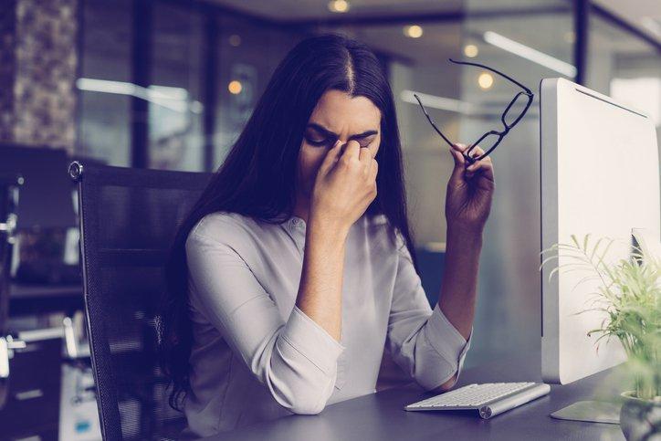 A woman at job, sad and depressed