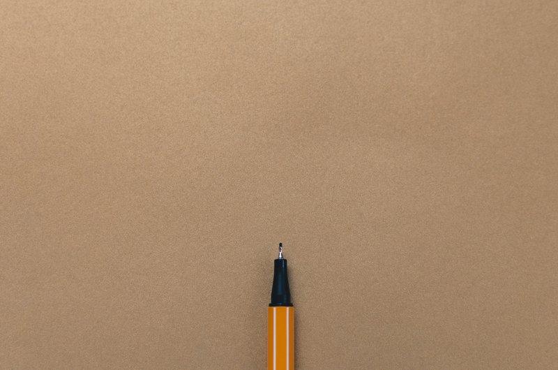 Black Marker on Gold Paper