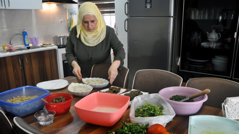 Samar is the head chef of Karadish Kitchen. Her husband Youssef Alozon creates all desserts, pastries, and manages food deliveries. Every weekday morning Karadish Kitchen sends out WhatsApp messages announcing their dishes of the day to their customers. Samar al-Mallah is a homemaker turned successful businesswoman, who fled Syria with her family to start a new life in Istanbul. Despite all obstacles, Samar has created a thriving catering business using WhatsApp, called Karadish Kitchen.