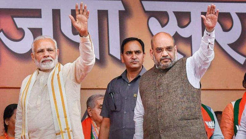 Narendra Modi & Amit Shah, architect of the BJP India WhatsApp Election Campaign.