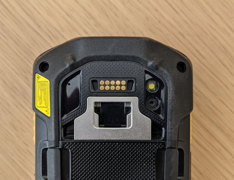 A rugged phone, reverse side, showing the robust charging mechanism, which is a superior option to consumer phone charging options – even if rugged phone cases are used.