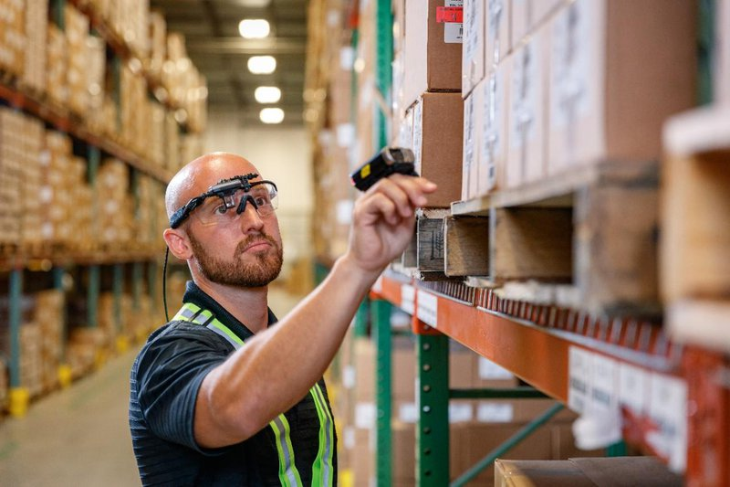Wearable wearables: smart glasses and a ring scanner help a worker quickly pick stock.