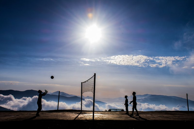Village kids playing volleyball here every morning, above the clouds