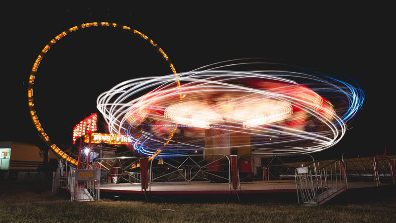 Neon light trails at fairground