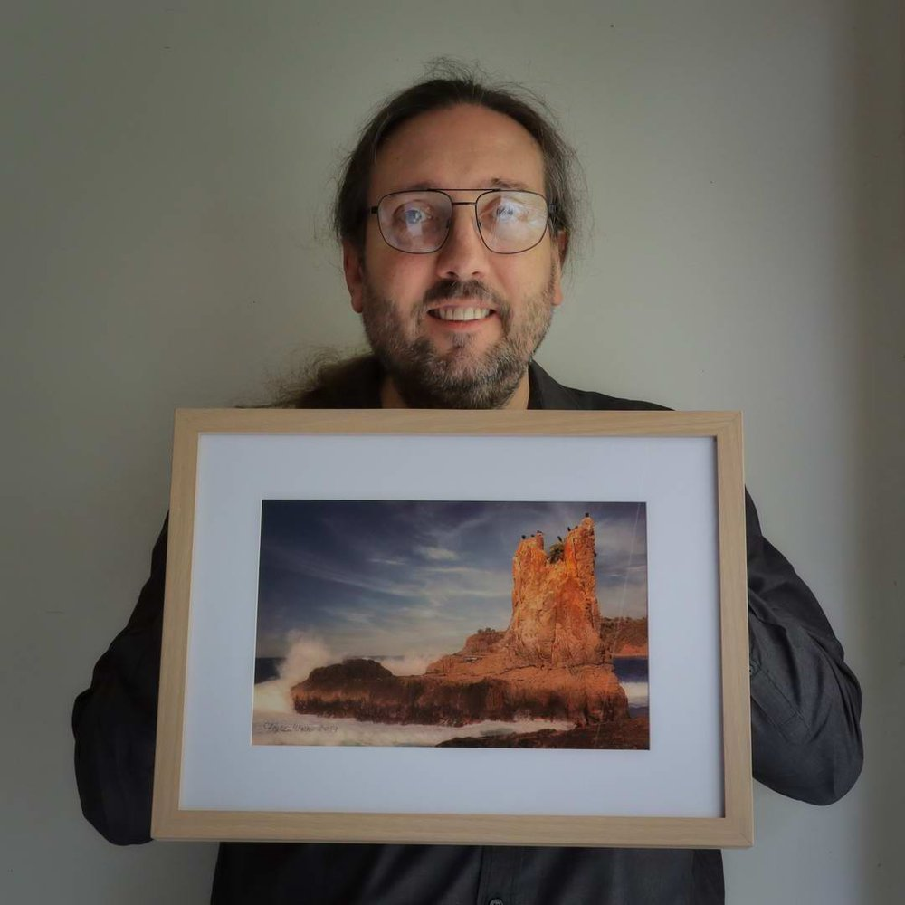 Stephen with his photo of Cathedral Rock, Kiama, NSW.