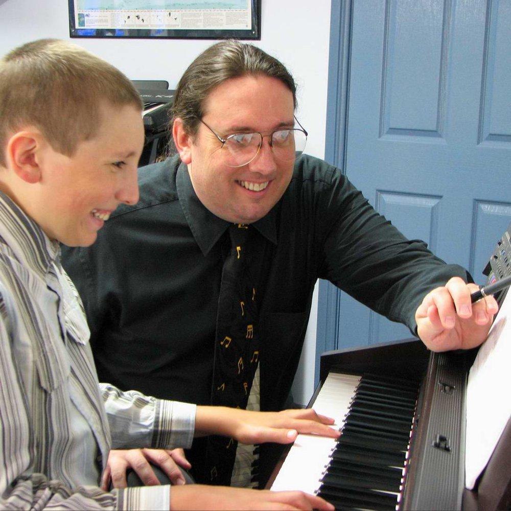 Stephen teaching a piano lesson.
