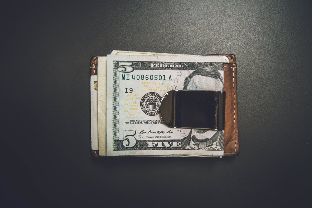 cash clipped to wallet