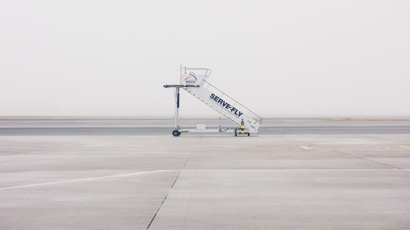 A photo of an airplane staircase on wheels parked on a runway as a metaphor for a startup runway
