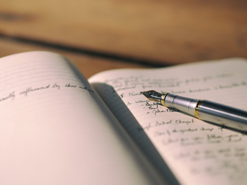 Writing with a fountain pen in a journal