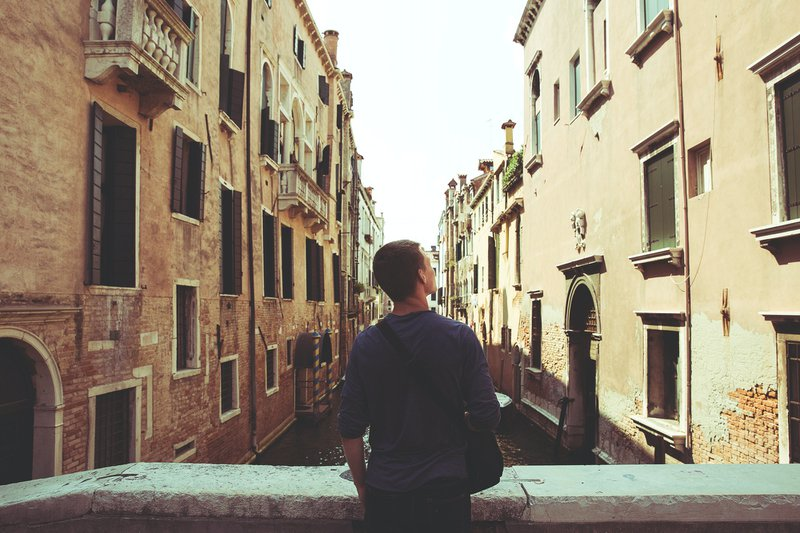 Male tourist enjoying the view in Venice