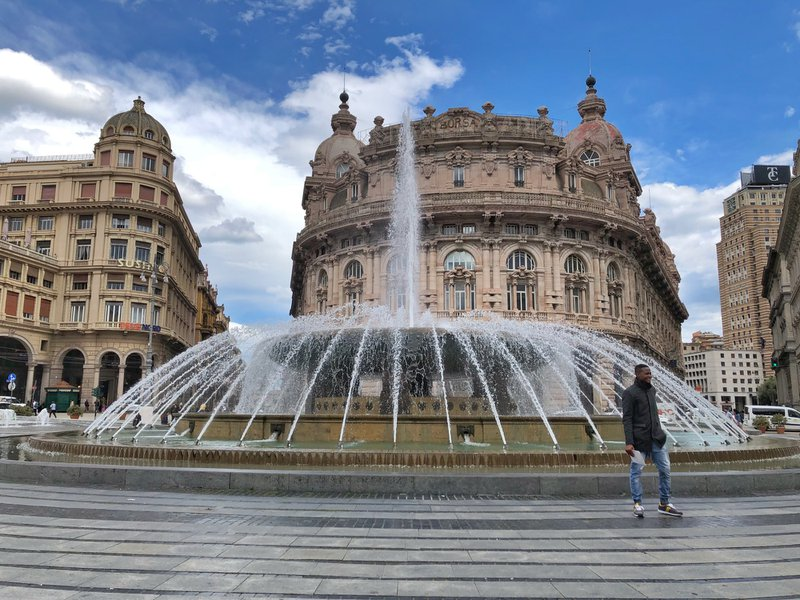 Incredible fountain in Genoa Italy.  Loved watching people pose in-front of it.  Happy to be on vacation. Genoa a great city in Italy to visit.