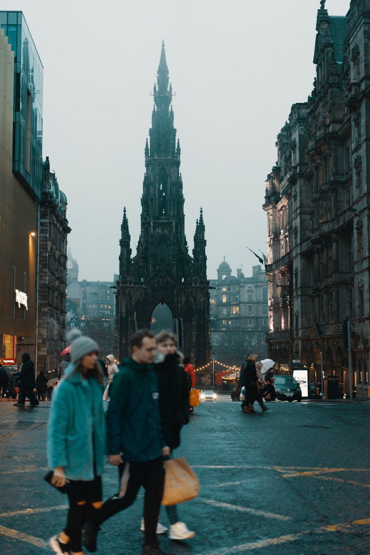 People shop in Edinburgh, on a cold, foggy Saturday