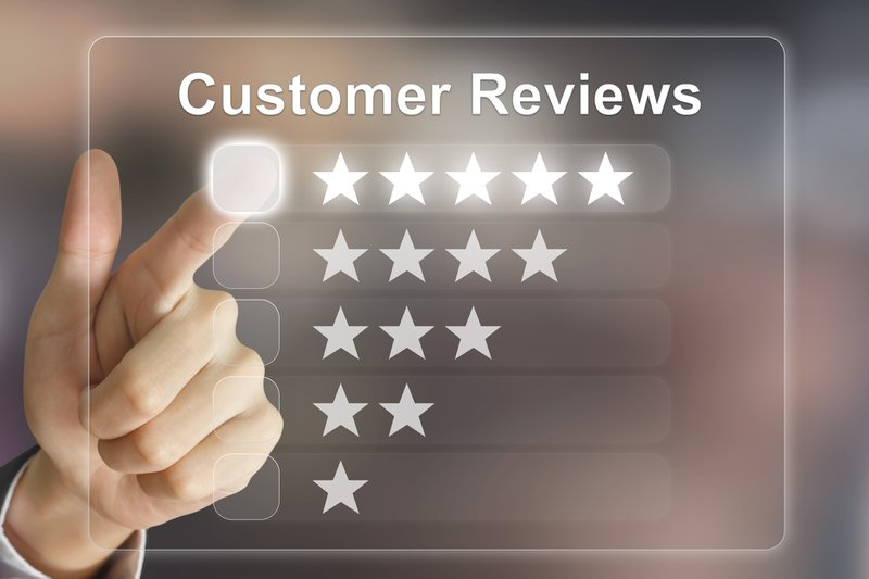 positive reviews -- man pointing to five stars as a customer review