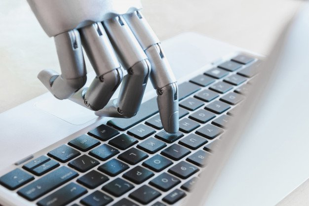 robotic hand typing on keyboard, emulating chatbots