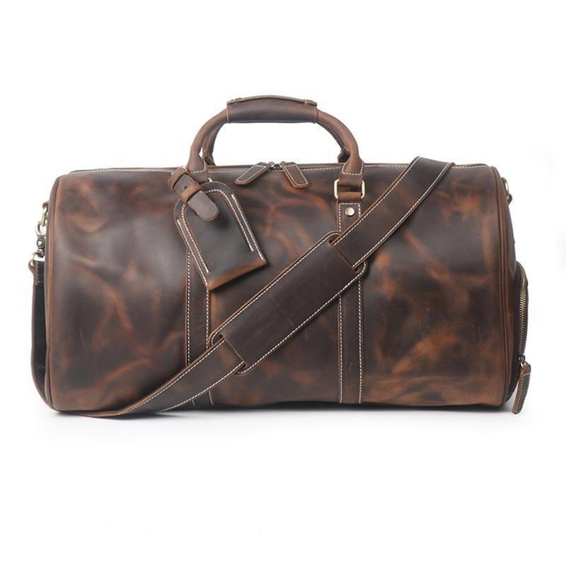 aged leather duffel bag