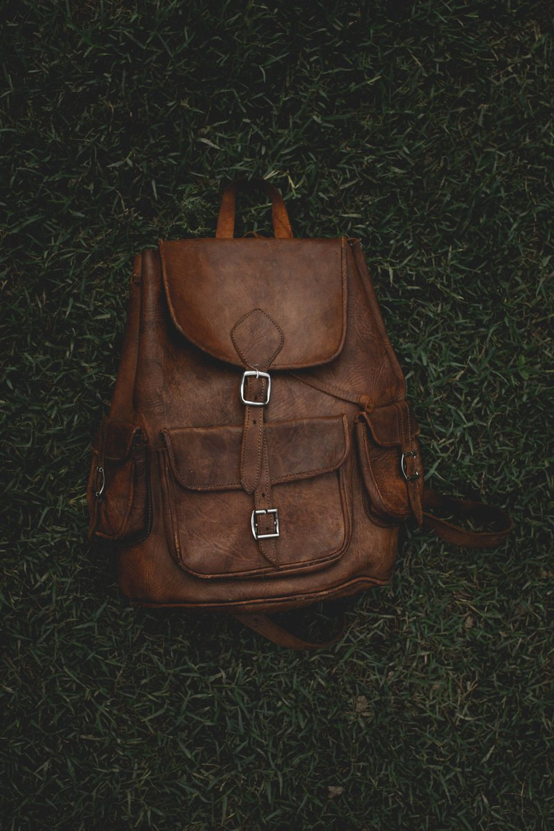 old vintage back bag in the forest