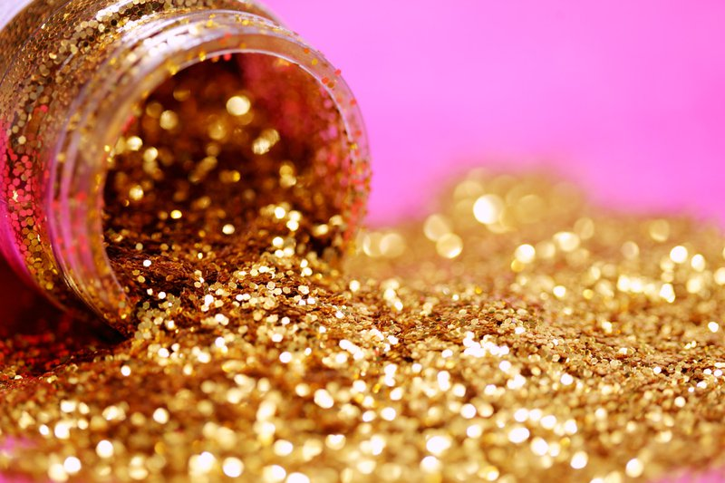 A close up macro shot of a bottle of fabulous gold glitter! It is snowing today, so I am staying inside and creating photos to keep busy.