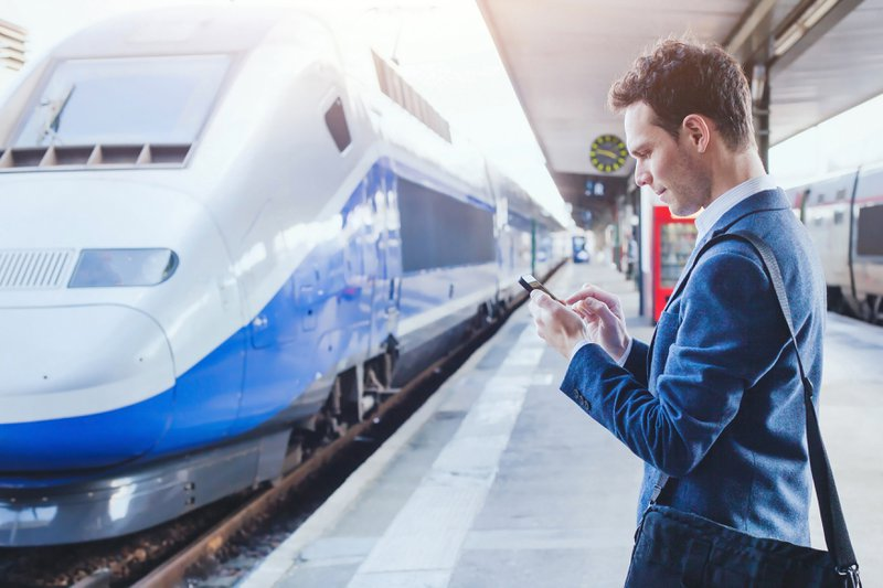 Business person using mobile app while traveling for work
