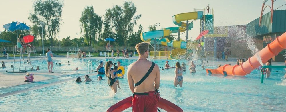 Lifeguard watching a swimmers in a waterpark.