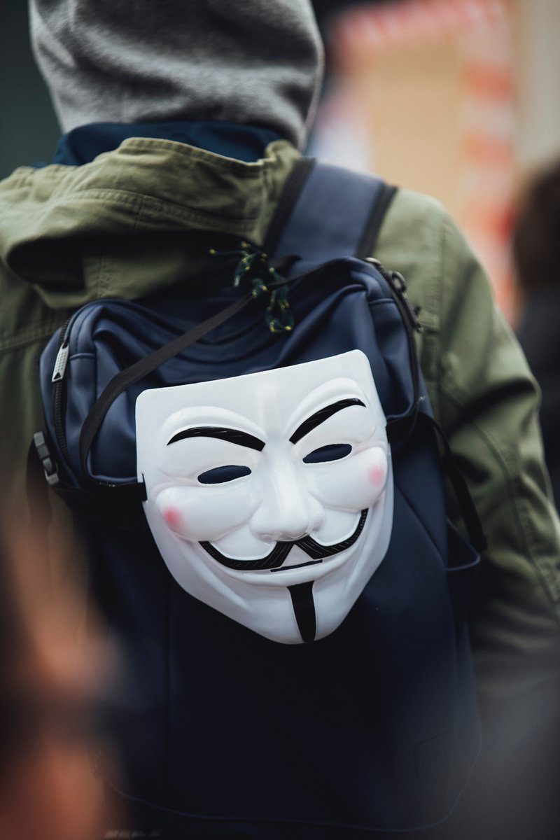 hacker mask on backpack