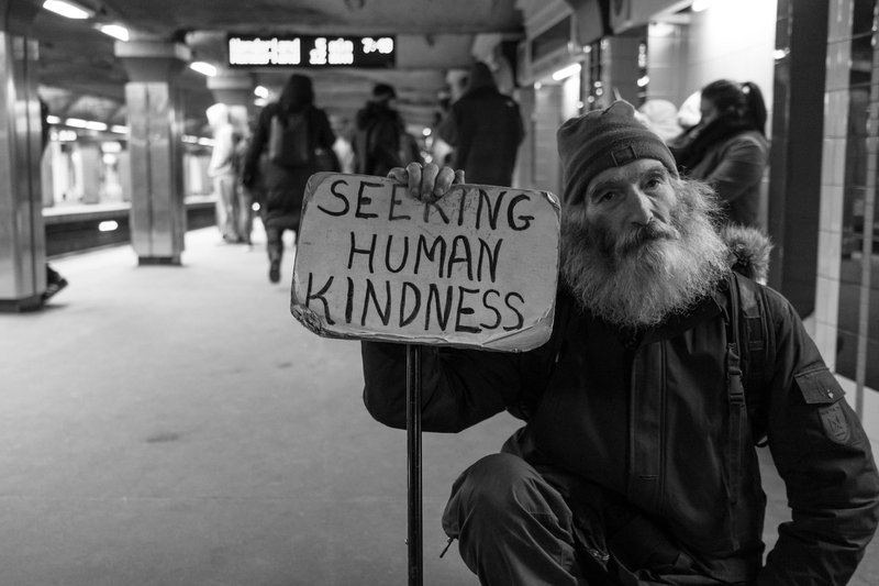 """I met Michael in a Boston subway station. I told him I liked his sign. """"What matters is what it means to you,"""" he told me.  I asked what it meant to him. """"Doing a deed or expressing kindness to another person without expecting anything in return,"""" Michael said.  I love approaching strangers wherever I go. Listening and talking to them teaches you about people and how similar we all are to one another. Just like Michael, we're all seeking human kindness."""