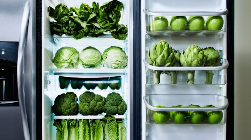 refrigerator full of green veggies