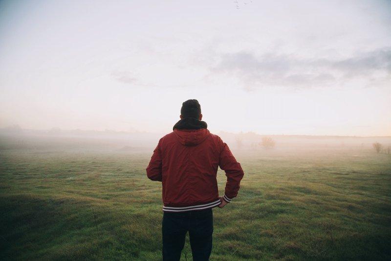 healthy Man in a foggy green field