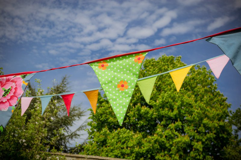 summer bunting and blue skies at our PTA summer fayre
