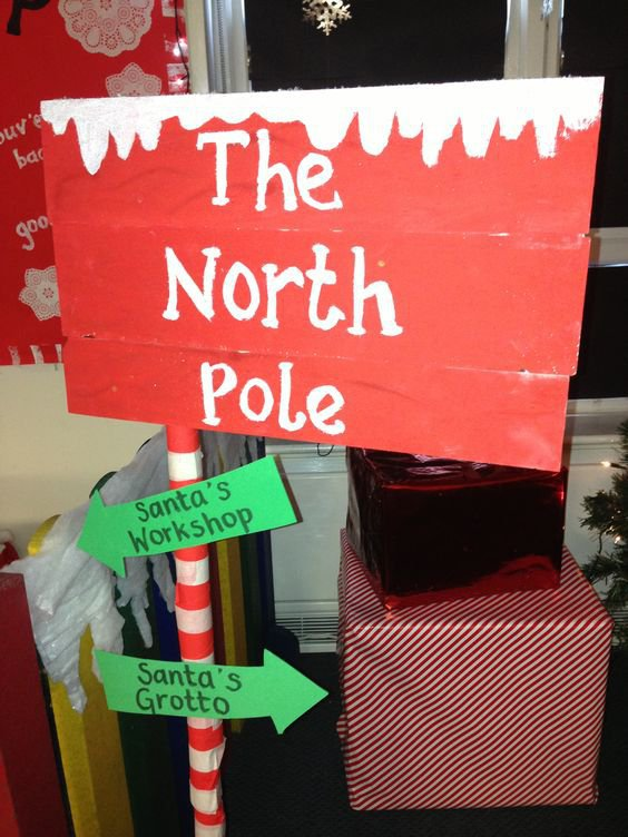 Sign pointing to the THe North Pole Santa's Workshop and Santa's Grotto