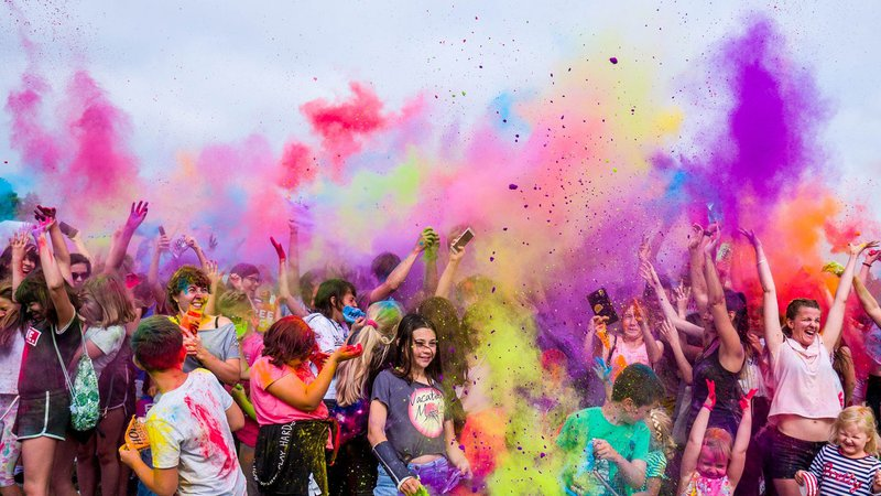 School Leavers Families celebrating with colourful powders