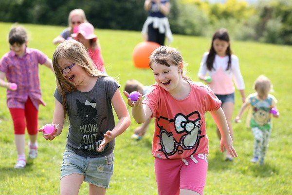 kids running and laughing in PTA egg-and-spoon race - summer fundraising events