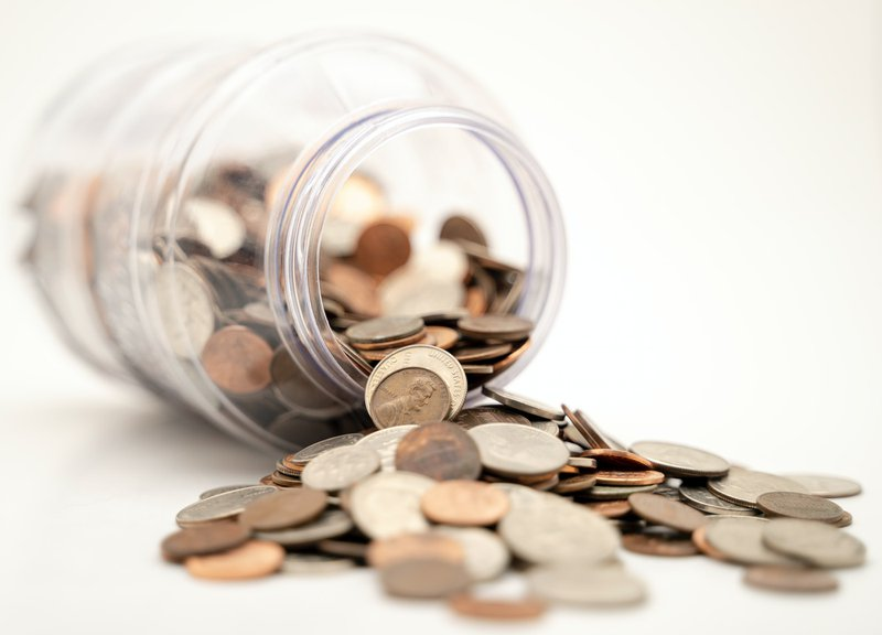 Coins spilling out of jar - start your online fundraising campaign instead