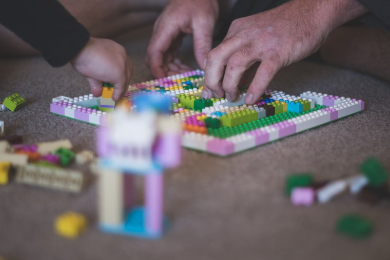 Dad and kids in home-schooling lockdown lego activity