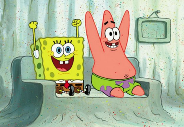 Spongebob and Patrick sitting down, throwing hands in the air, being happy