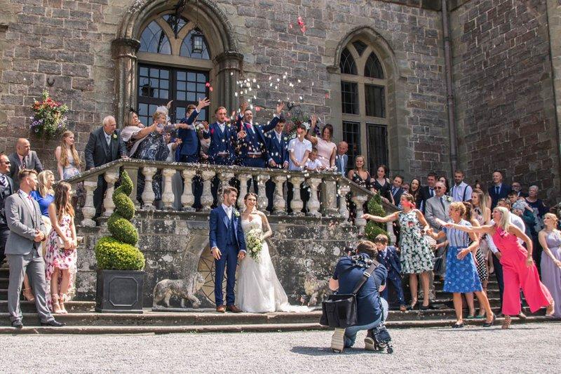 wedding photos - photographer takes a group shot