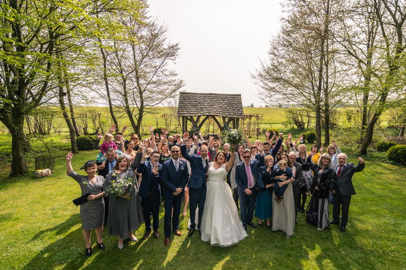 group wedding photos - big group shot in a field