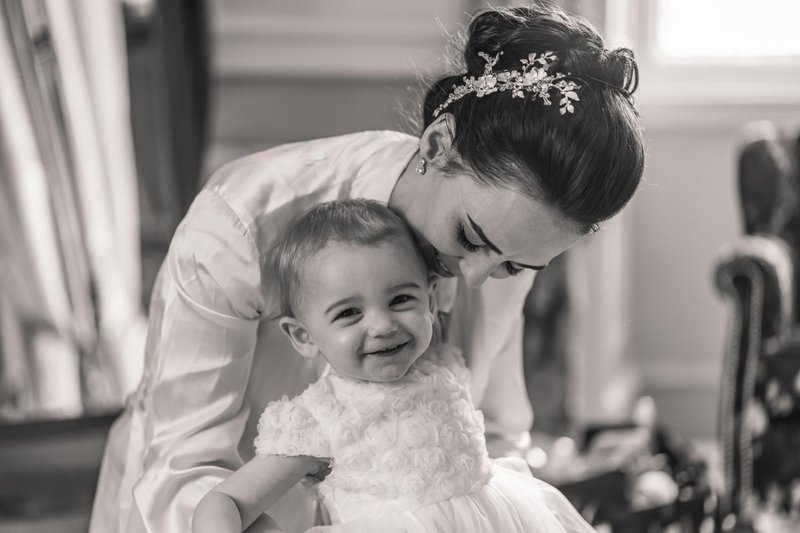 candid wedding photography - a bride and her child