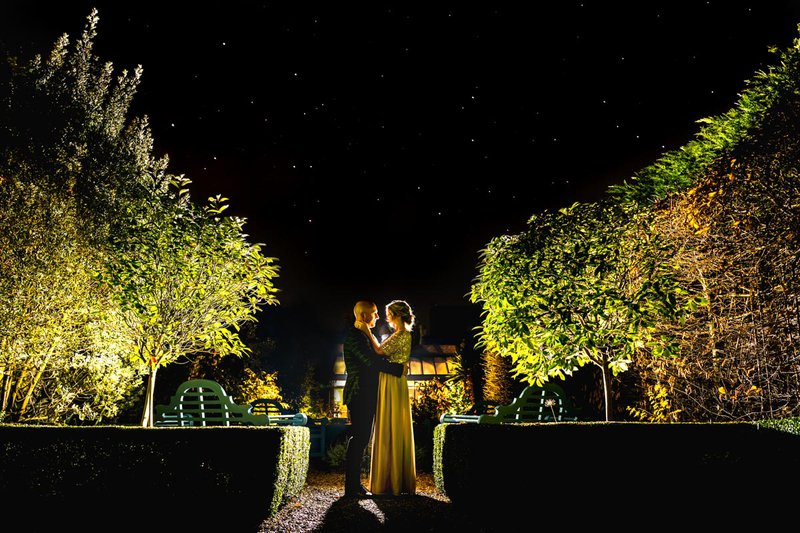 wedding photos - a bride and groom embrace at night