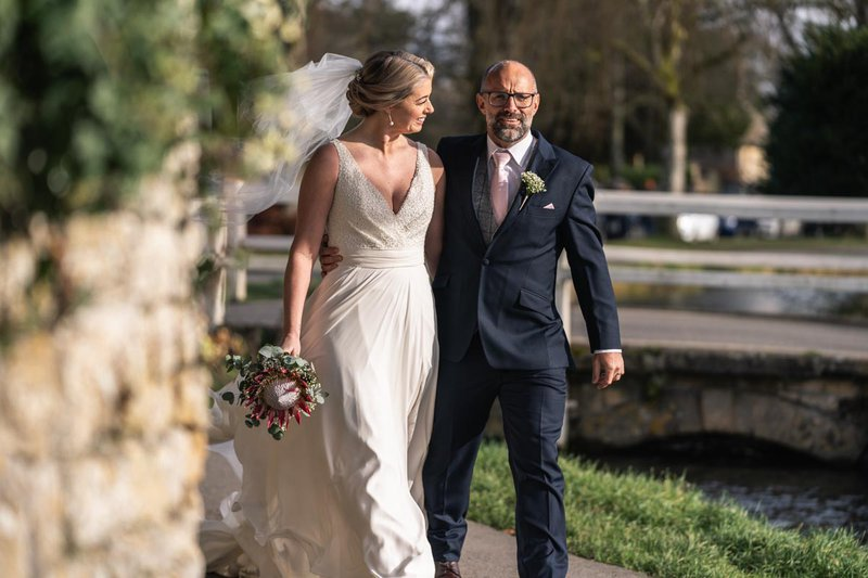 wedding photos - bride and groom walk together