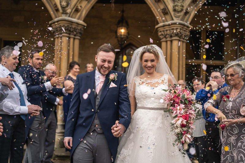 wedding photos - bride and groom with confetti